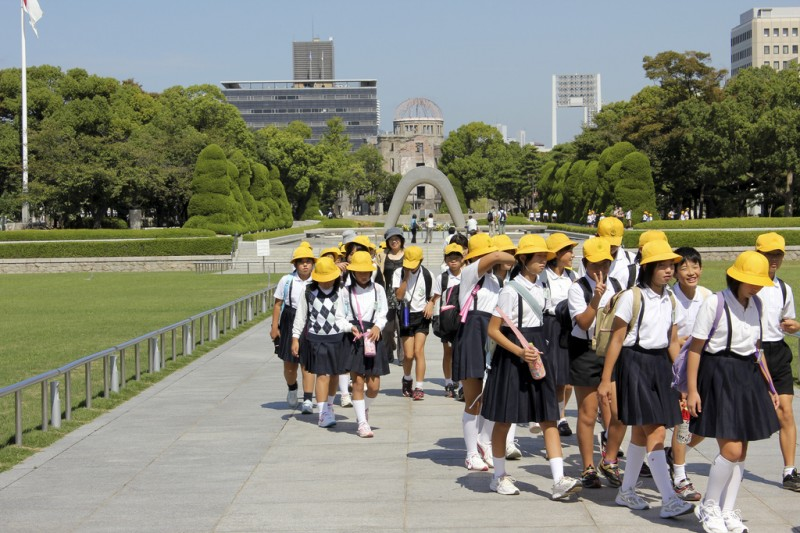 Many students visit Hiroshima for school trip. Photo taken at Hiroshia Peace Memorial Park by flickr user Magalie L'Abbé